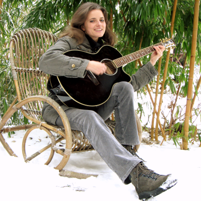 beloved-child plays guitar in the snow
